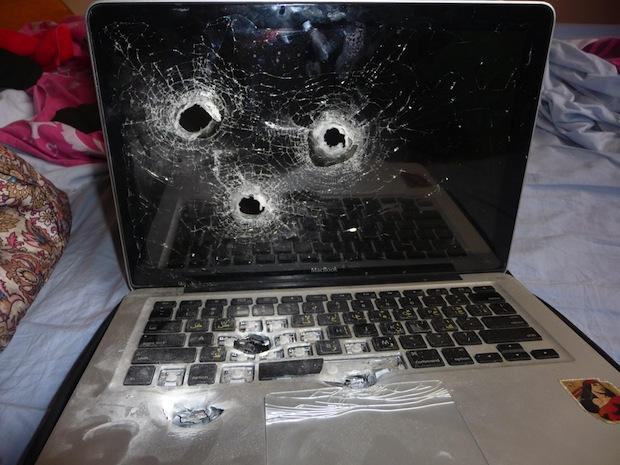 Vernon Cell Repair - mac book with bullet holes